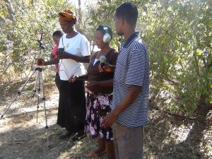 Participants learning how to use the participatory video equipment